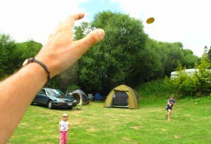 Playing frisbee at a campsite