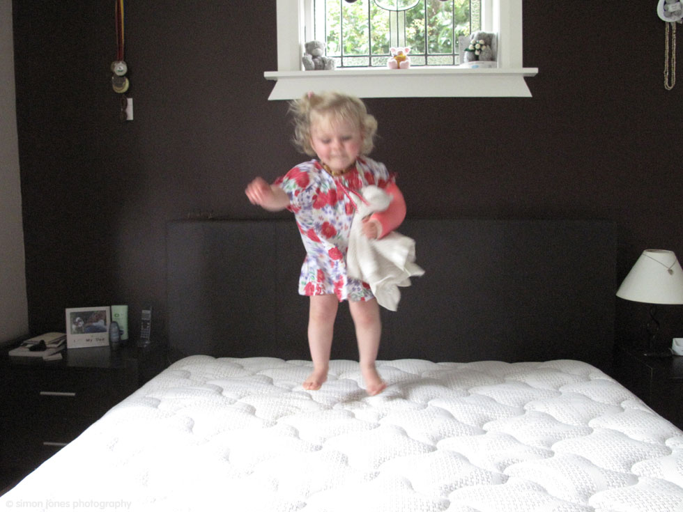Little Grace jumping on the bed