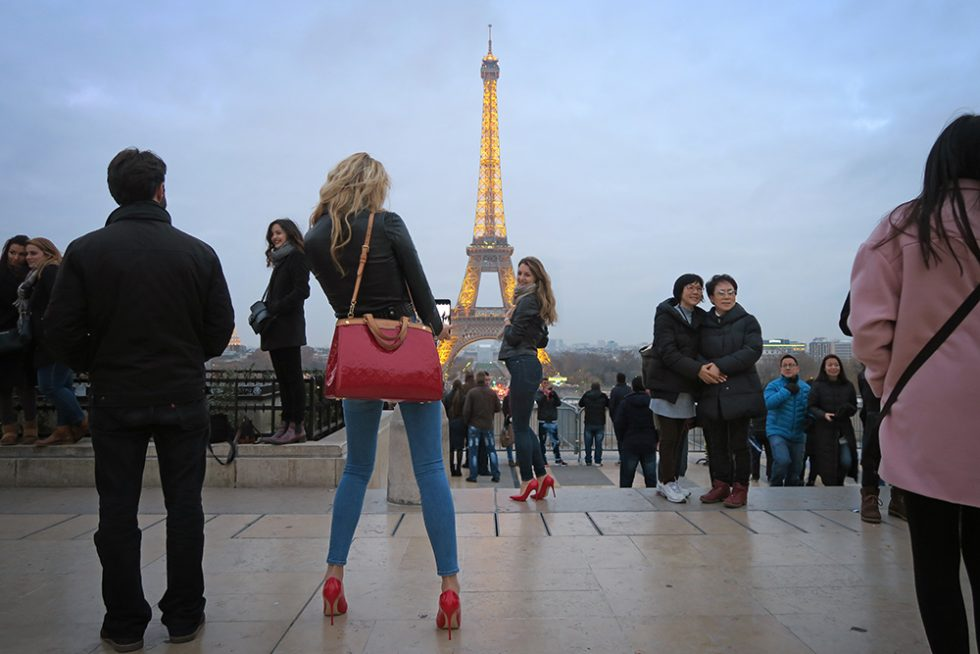 Girls taking pictures in Paris